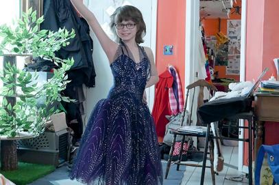 Trans girl Ren poses in a dress she will wear in the Lil Miss Westie pageant.